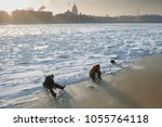 Small photo of St. Petersburg, Russia - February 15, 2012: Panorama of the Neva - English and Admiralty embankment. In the foreground: fishermen catch a smelt of smelt from under the ice.