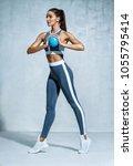 slender athletic girl with ball ... | Shutterstock . vector #1055795414