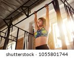 fit young brunette woman in... | Shutterstock . vector #1055801744