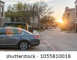 row of different cars parked in ... | Shutterstock . vector #1055810018