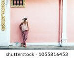 boho girl walking on the city... | Shutterstock . vector #1055816453