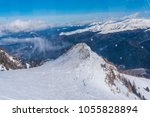 clouds at the peak of mountain | Shutterstock . vector #1055828894