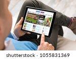man reading sports news on...   Shutterstock . vector #1055831369
