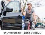 angry young bicyclist shouting... | Shutterstock . vector #1055845820