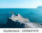 girl standing on the mountain... | Shutterstock . vector #1055847470