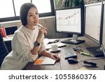 young analyst  trader  marketer ... | Shutterstock . vector #1055860376
