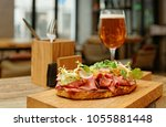 sandwich with roast beef...   Shutterstock . vector #1055881448