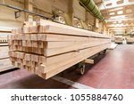 stack of pile wood bar in... | Shutterstock . vector #1055884760