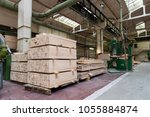 stack of pile wood bar in... | Shutterstock . vector #1055884874