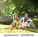 Cheerful family on a picnic - stock photo