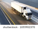 white truck on highway road... | Shutterstock . vector #1055902370