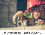 Caucasian Masonry Worker in Hard Hat. Construction Site Theme. - stock photo