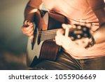 caucasian guitarist playing... | Shutterstock . vector #1055906669