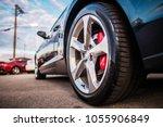 car on the parking spot. alloy... | Shutterstock . vector #1055906849
