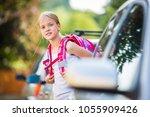 cute little girl going home... | Shutterstock . vector #1055909426