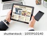 businessman reading business... | Shutterstock . vector #1055910140
