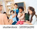 group of children are pulling... | Shutterstock . vector #1055916290