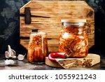 cabbage kimchi glass jar.... | Shutterstock . vector #1055921243