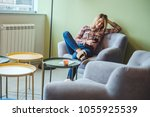 woman smiling  sitting on a... | Shutterstock . vector #1055925539