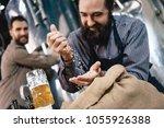 joyful bearded brewer sifts... | Shutterstock . vector #1055926388