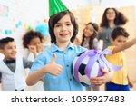 joyful little boy in green... | Shutterstock . vector #1055927483
