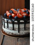 cake decorated with blueberries ... | Shutterstock . vector #1055932160