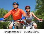 young smiling couple cycling... | Shutterstock . vector #105593843
