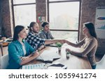 side view of pretty hr manager... | Shutterstock . vector #1055941274