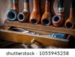 display of smoking pipes on a...   Shutterstock . vector #1055945258