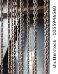 Small photo of Hanging chains hard steel metal industrial elements and textures background