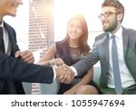 handshake manager and the... | Shutterstock . vector #1055947694
