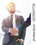 bussines hand shaking will show ... | Shutterstock . vector #1055947778