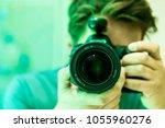 camera photographer lens... | Shutterstock . vector #1055960276