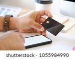 online payment concept. man...   Shutterstock . vector #1055984990