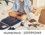 an asian male traveler is... | Shutterstock . vector #1055992469