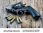 old snubnose 45 pistol with six ... | Shutterstock . vector #1056002309