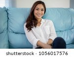 asian women smiling happy for... | Shutterstock . vector #1056017576