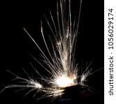 lighter ignition close up sparks | Shutterstock . vector #1056029174