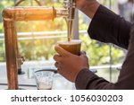 made nitro cold brew coffee in... | Shutterstock . vector #1056030203