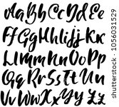 handdrawn dry brush font.... | Shutterstock .eps vector #1056031529