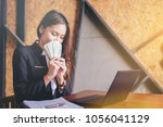 businesswoman succeed and earn... | Shutterstock . vector #1056041129