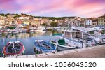 vivid sunset at colorful ... | Shutterstock . vector #1056043520