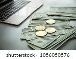 gold coins of bitcoin on dollar ... | Shutterstock . vector #1056050576
