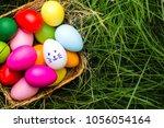 row of easter eggs in fresh... | Shutterstock . vector #1056054164