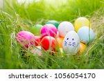 row of easter eggs in fresh... | Shutterstock . vector #1056054170
