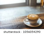 a cup of coffee with heart... | Shutterstock . vector #1056054290