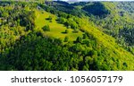 aerial view of forest in... | Shutterstock . vector #1056057179