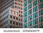 marble skyscraper with long... | Shutterstock . vector #1056064079