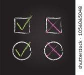 chalk check marks on black...   Shutterstock .eps vector #1056065048