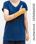 Small photo of insurance sport, badminton player with wrist splint on arm